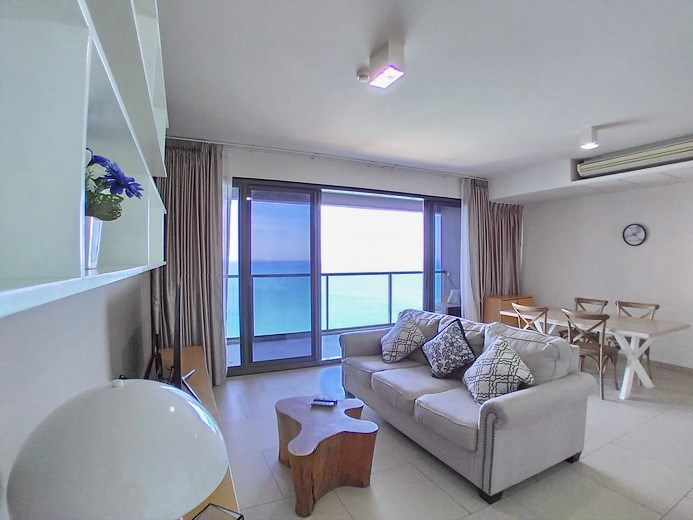 Condominium for rent Wong Amat Pattaya showing the living, dining areas and balcony
